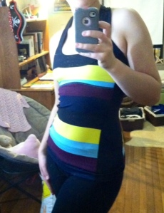This multicolored scoop neck top is extremely flattering, and the black panels down the sides make it highly slimming as well. The back is also really gorgeous - almost too pretty to wear to the gym! My only complaint is that it didn't come with removable cups. At least I had my own to throw in - no headlights for this gal!