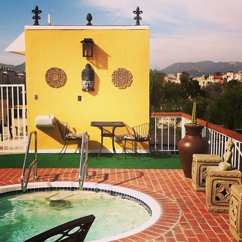 The roof of their apartment - Hollywood sign in the background, hot tub in the foreground.