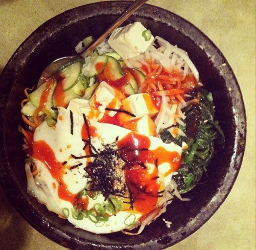 Korean stone bowl with tofu, rice, veggies, a fried egg, and slightly spicy and sweet sauce drizzled on top. Don't tell me that's not internet-worthy!